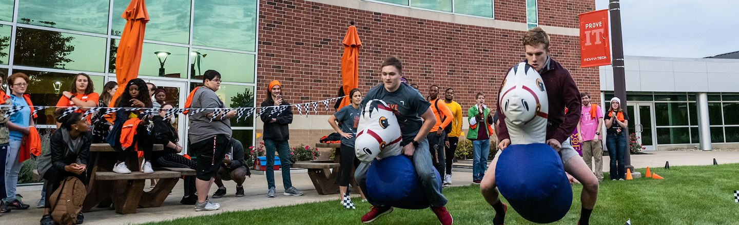 students gathered outside of Andorfer building participating in games during homecoming week