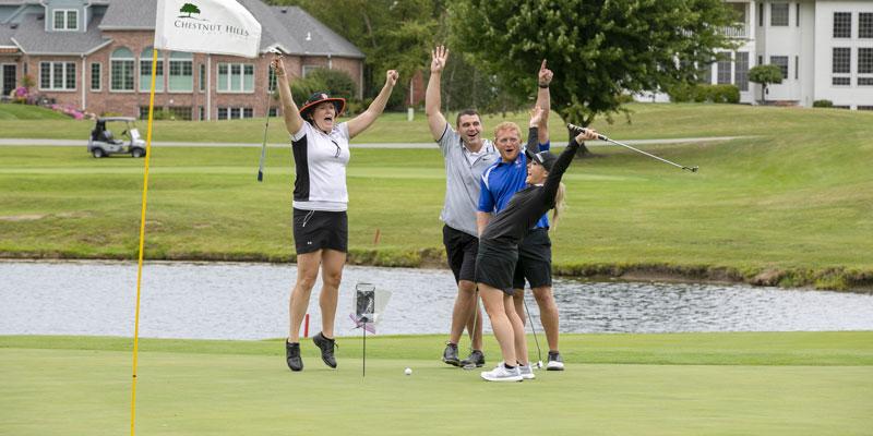 TWIST golfers celebrating a put