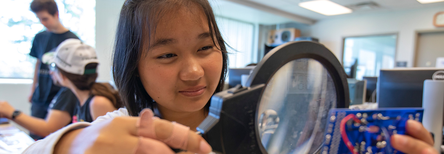 High School student participating in a project during the High School Summer Engineering Summer Camp