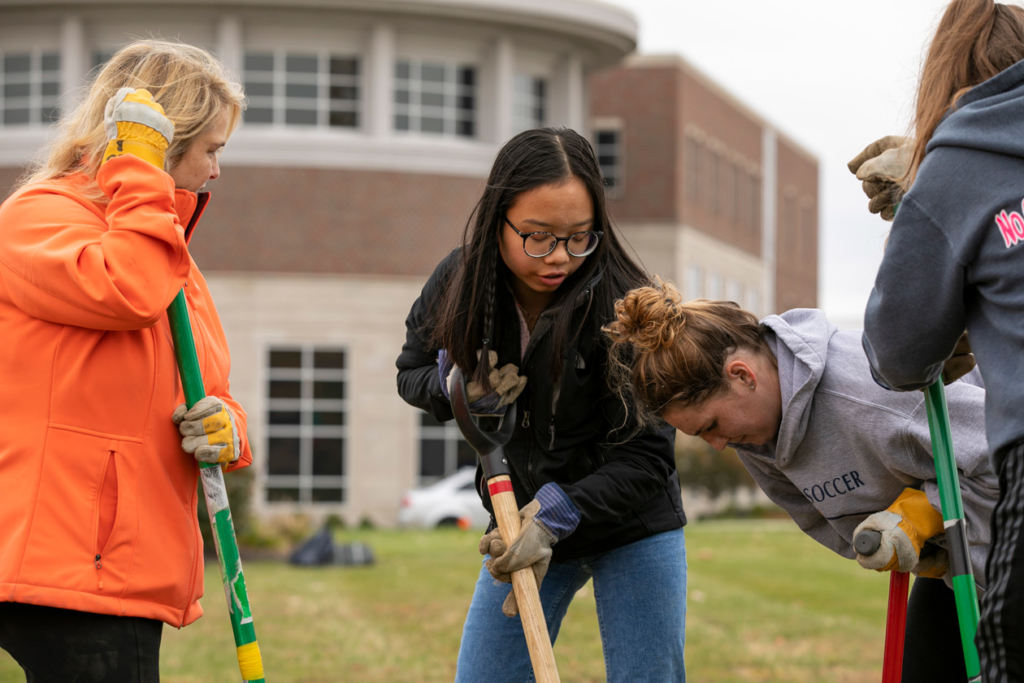 Indiana Tech Students from the Green Team advocating sustainability by planting trees on campus
