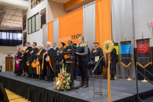 Student lead pledge of allegiance during President Karl W. Einolf's Inauguration