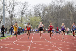 Indiana Tech track athletes running against visiting teams on the outdoor track