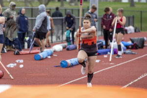 Indiana Tech track athlete preparing to jump in a pole vault