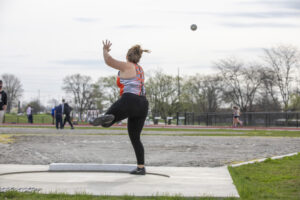 Indiana Tech student athlete throwing a shot put