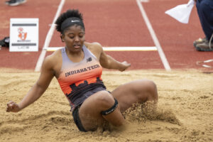 Indiana Tech track athlete completing a long jump