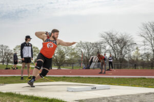 Student preparing to throw a shot during shot put at the Indiana Tech Warrior Park field