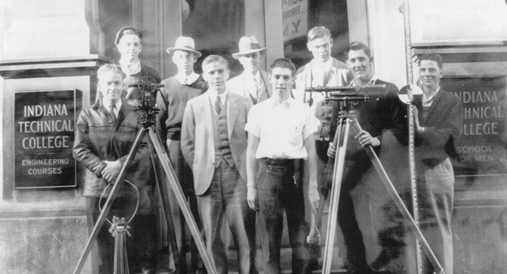 Indiana Tech students standing in front of the original location for Indiana Technical Institute
