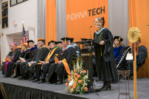 Previous faculty of the year Sherrill Hamman speaking at the Inauguration of President Karl W. Einolf