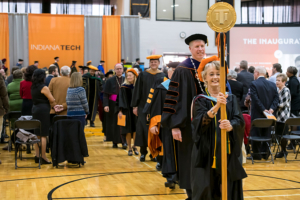 Sherrill Hamman leading the board of trustees and honored guests marching together during the inauguration of Karl W. Einolf