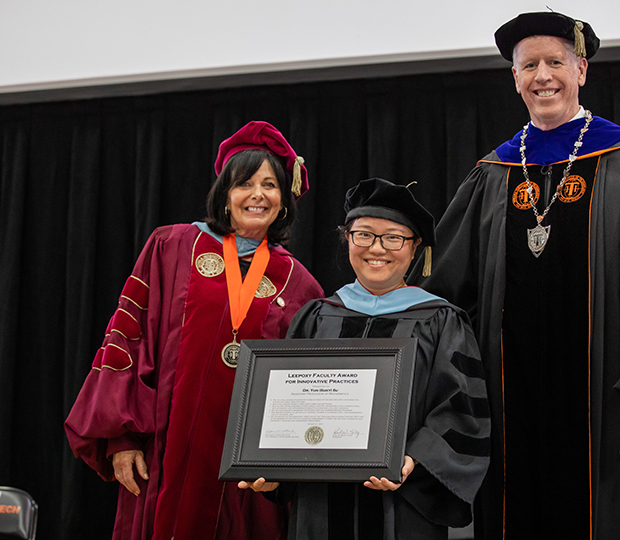 from left to right, VPAA Dr. Katherine Watland, Dr. Yun Su and President Karl Einolf