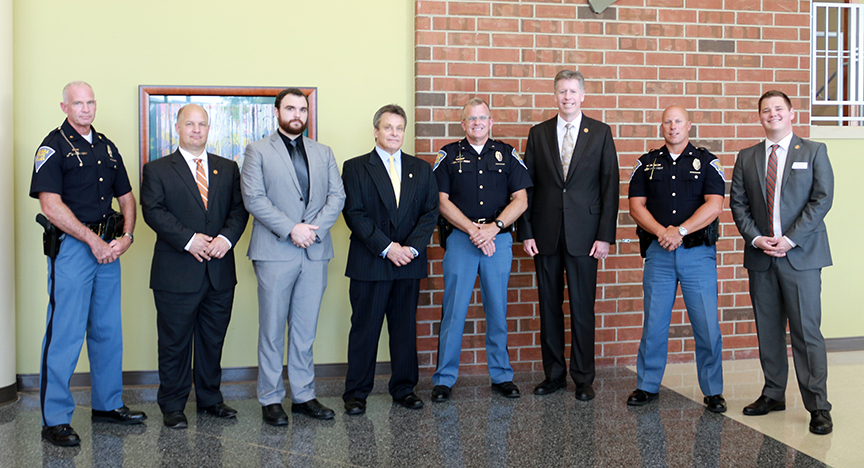 From left to right: Indiana State Police major Danny Price, Indiana Tech vice president for Academic Affairs, Dr. Thomas Kaplan; associate professor of criminal justice, Tyler Counsil; director of Indiana Tech's Center for Criminal Justice, Dominic Lombardo; Indiana State Police superintendent Douglas Carter; Indiana Tech president Dr. Karl Einolf; Indiana State Police sergeant Matt Voorhees; Indiana Tech admissions representative Jackson Huff