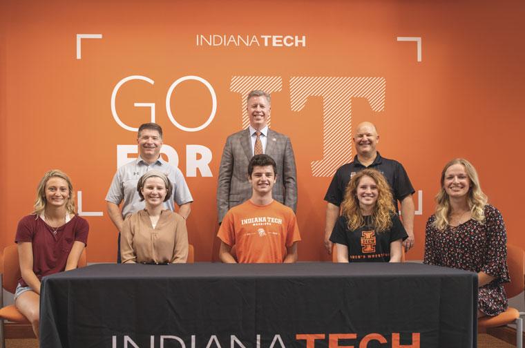President Einolf, Dr. Dan Stoker and Dr. Thomas Kaplan posing with Indiana Tech leader scholars