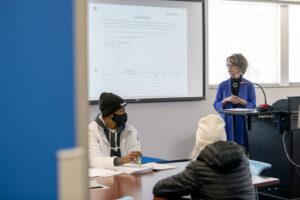 Sherrill Hamman instructing students in class